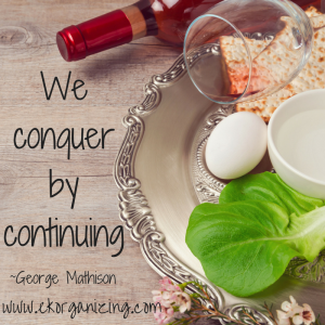 "Pesach platter display with quote ""We conquer by continuing"""